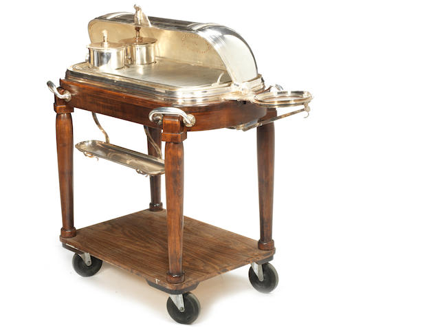 A silver-plated and wood beef warming/serving trolley