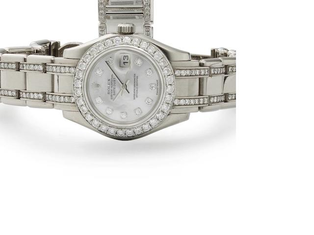 Rolex. An 18ct white gold and later diamond set calendar bracelet watch Pearlmaster, Ref:80329, Serial No.P193***, Movement No.025****, Circa 2000