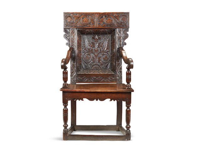 An exceptionally rare and fine early 17th century oak recessed panel-back open armchair, Somerset, circa 1620-30