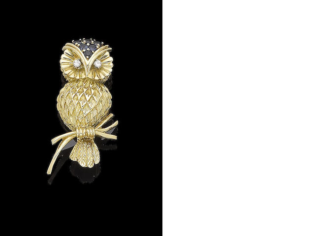 A sapphire and diamond owl brooch, by Tiffany & Co.