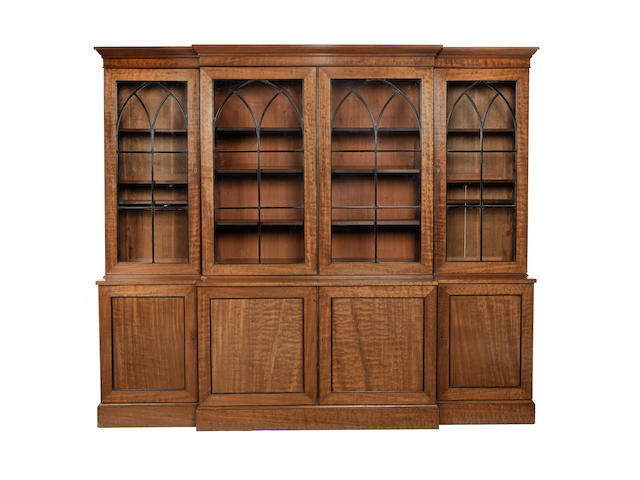A 19th century figured mahogany breakfront bookcase