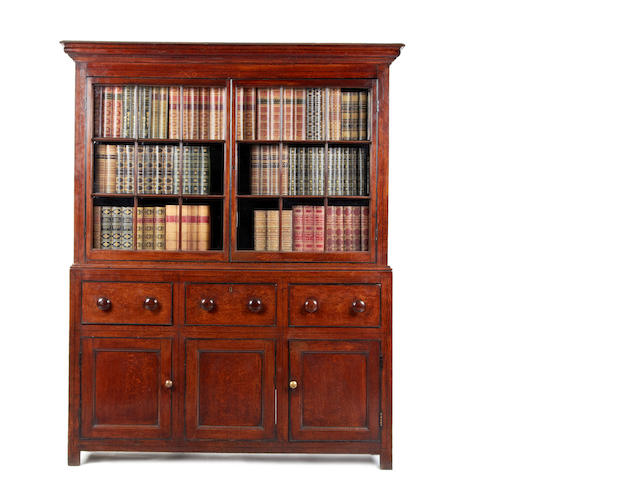 An early 19th century oak and ebony line inlaid bookcase cabinet, English