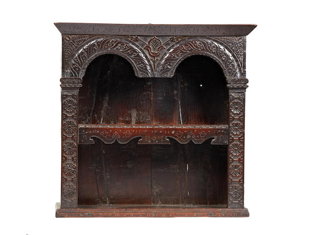 A fine and rare mid-17th century oak and elm boarded glass case, English, circa 1640-60