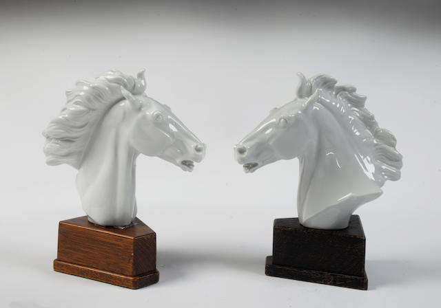 Two Meissen white horse's heads by Erich Oehme