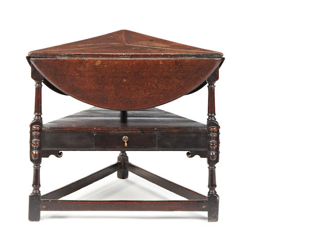 A rare William & Mary oak swivel-action joined folding-table, circa 1690-1700 Of cricket table type