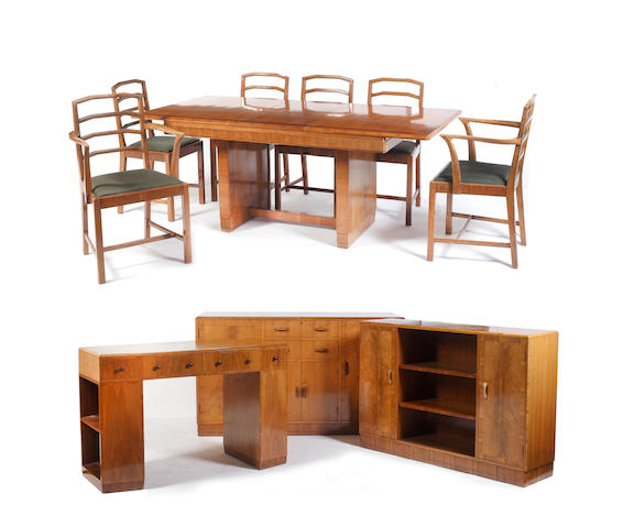 A Heals  walnut and crossbanded  dining suite comprising: