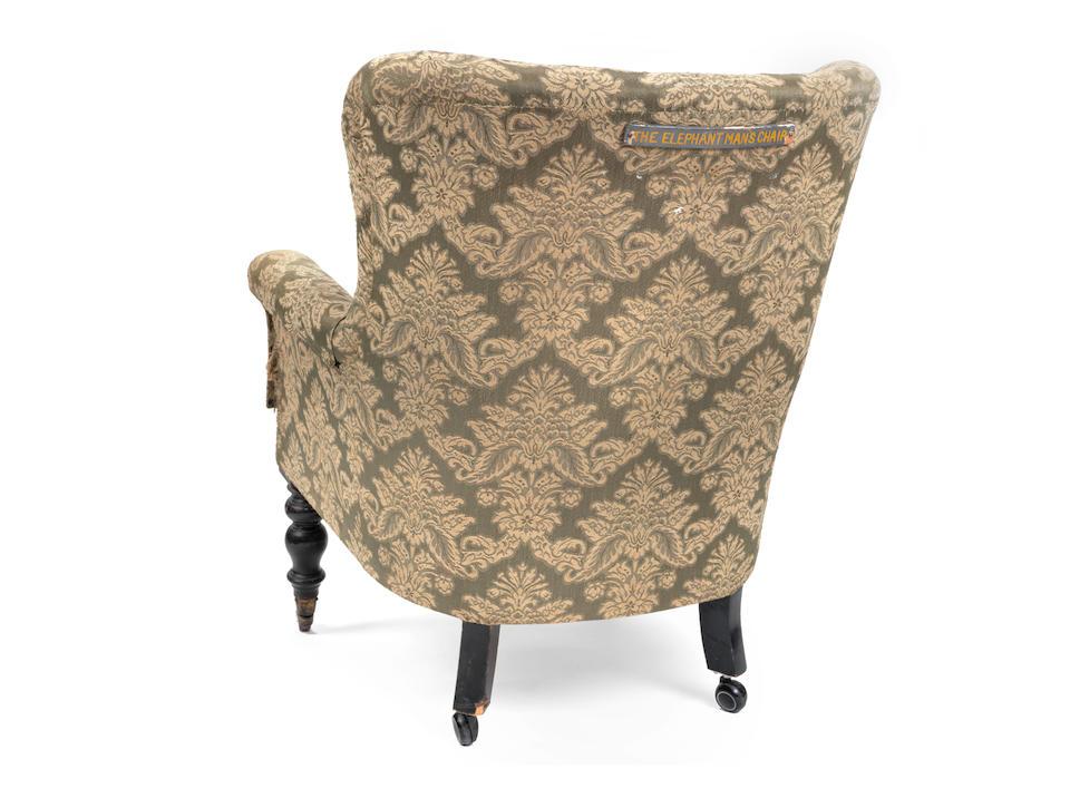 A Victorian ebonised tub back armchair owned by Joseph Merrick, 'the Elephant Man'