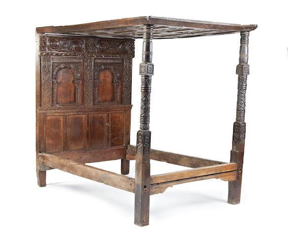 An early 17th century and later oak tester bed, English