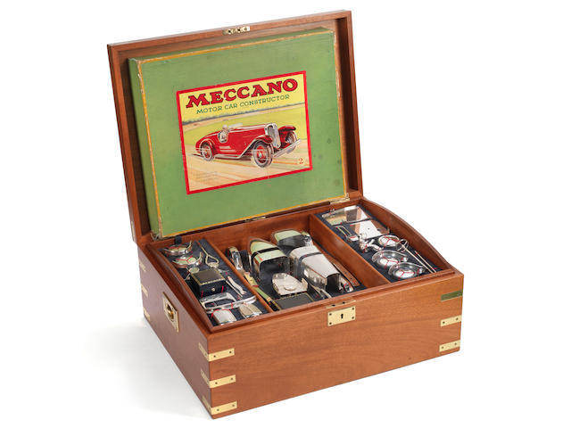 A boxed silver Meccano motor car constructor kit together with the original Meccano kit for the same vehicle the silver model with maker's mark for Garrard & Co Ltd, London 1995