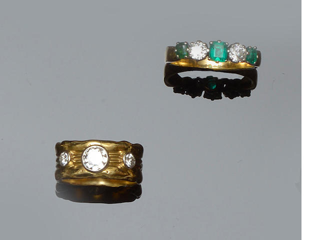 A diamond set band ring and an emerald and diamond ring (2)