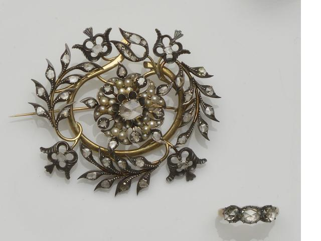 A diamond and pearl brooch and a three stone diamond ring (2)