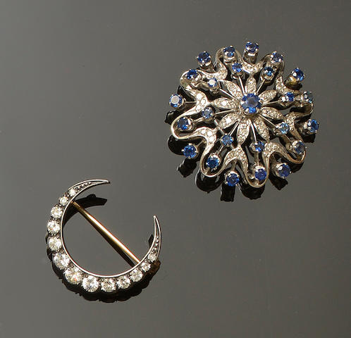 A diamond crescent brooch and a sapphire and diamond brooch (2)