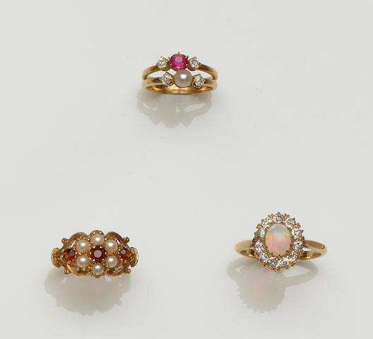 An opal and diamond cluster ring and six gem set rings (7)