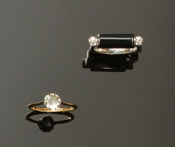 A diamond single stone ring and a black onyx and diamond set ring (2)