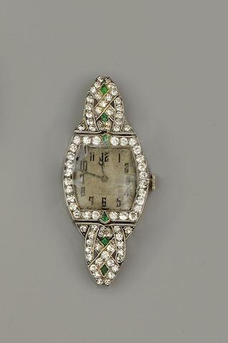 An emerald and diamond set watch head