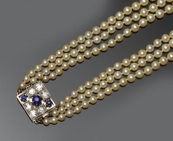 A cultured pearl necklace with sapphire and diamond clasp