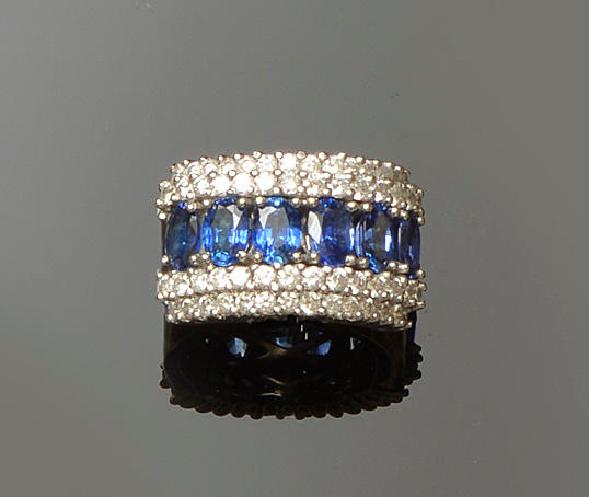 A broad sapphire and diamond band ring