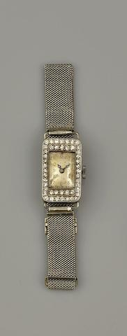 An Art Deco diamond cocktail watch and a diamond and pearl crossover ring (2)