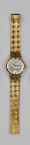 Longines: An 18ct gold gentleman's wristwatch