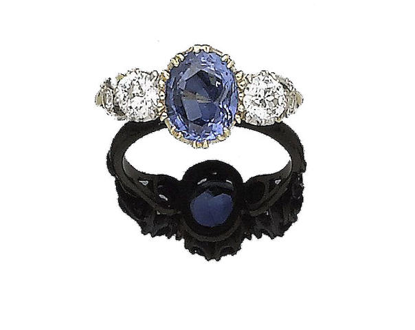 A sapphire and diamond three-stone ring,