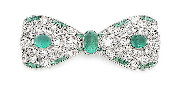 An art deco emerald and diamond bow brooch,
