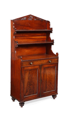 A Regency figured mahogany 'waterfall' chiffonier bookcase, in the manner of Gillows.