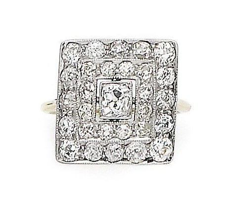 An early 20th century diamond panel ring