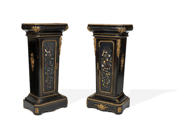A pair of third quarter 19th century hardstone inset, gilt brass mounted ebony and ebonised pedestal cabinets