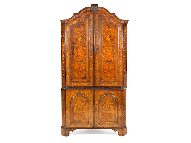 A Dutch 18th century walnut and fruitwood marquetry two-tier corner cupboard