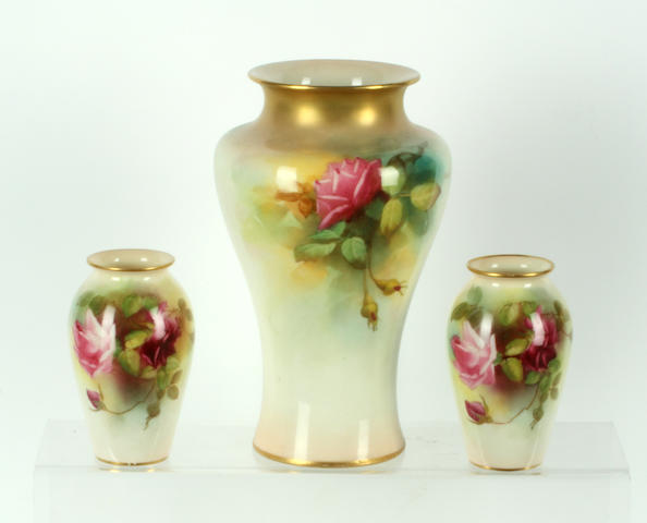 A Royal Worcester vase by F.Harper and a pair of small Royal Worcester vases, early 20th century