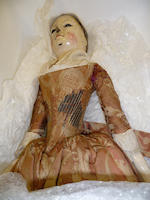 A large and important George II wooden doll, English 1725-30