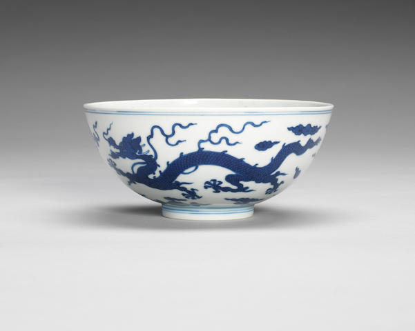 A blue and white 'dragon' bowl Qianlong seal mark and of the period