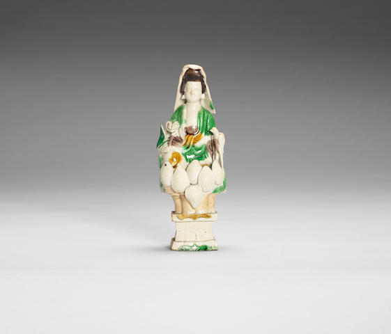 A famille verte biscuit model of Guanyin 17th century