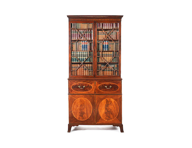 A George III mahogany, tulipwood and chequerbanded secretaire bookcase in the manner of Gillows