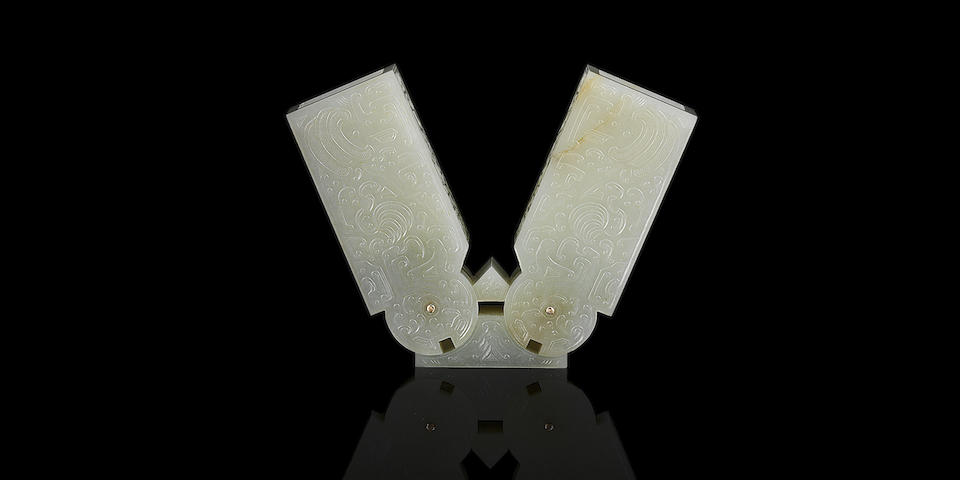 A rare Imperial white jade archaistic 'hinge fitting' Qianlong six-character fang gu mark and of the period