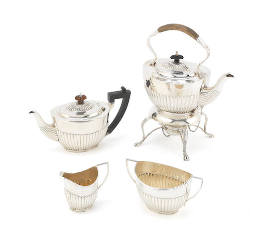 A Victorian silver four-piece tea service including kettle on stand by Charles Stuart Harris, London 1897 (4)