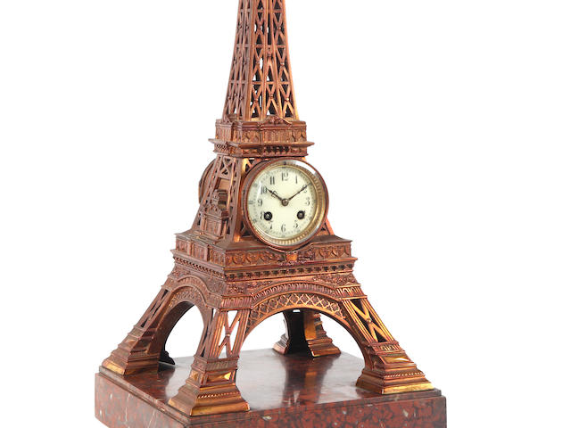 A late 19th century novelty clock modelled on the Eiffel Tower