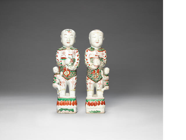 An associated pair of famille verte 'boys' joss stick holders  Kangxi