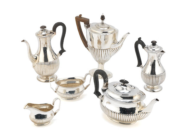 A Victorian silver matched six-piece tea and coffee service by William Hutton & Sons Ltd, London 1896 - 1898 (6)