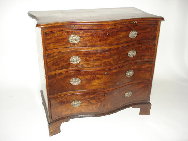 A George III mahogany chest of drawers of serpentine shape