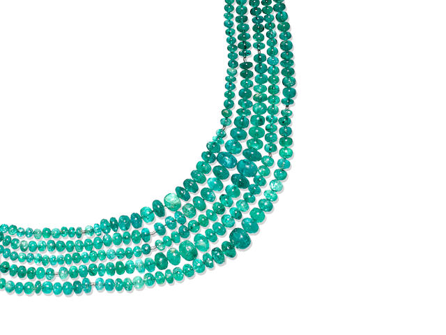 A multi-strand emerald bead necklace