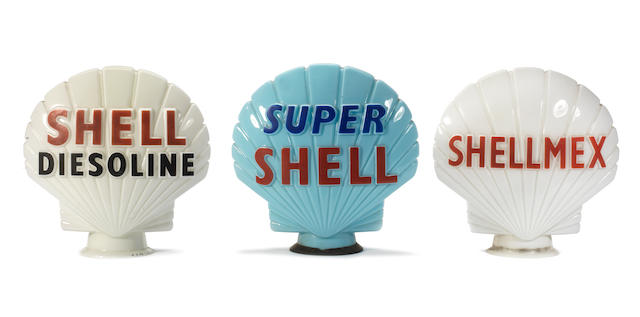 Three Shell glass petrol pump globes,