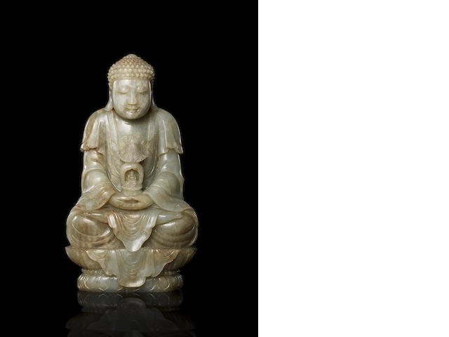 A rare Imperial pale green jade figure of Buddha 18th century