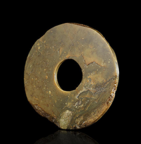 A rare olive-green jade disc, bi  Late Neolithic Period