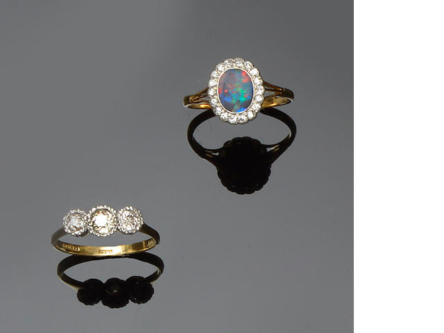 A black opal and diamond cluster ring and a diamond three stone ring (2)