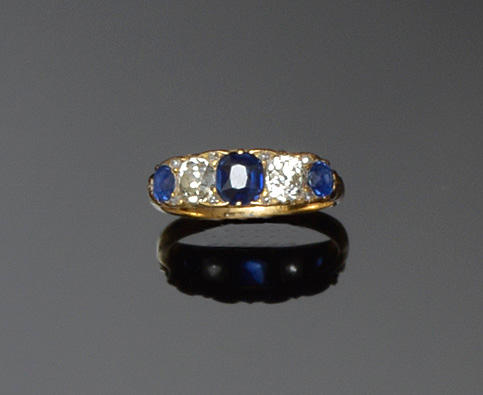 A sapphire and diamond five stone ring
