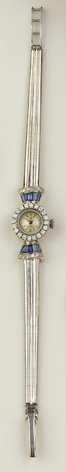 Omega: A lady's sapphire and diamond set wristwatch