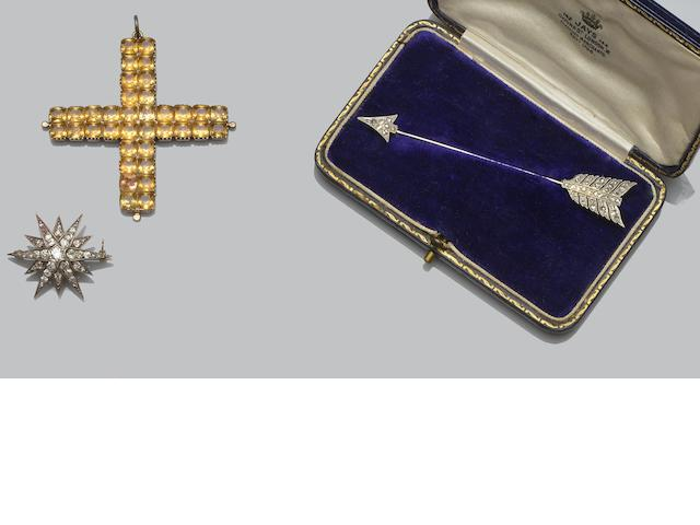 Two diamond set brooches and a paste cross pendant (3)