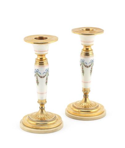 A pair of early 20th century Austro-Hungarian enamelled silver-gilt candlesticks by Georg Adam Scheid, Vienna, circa 1910 (2)