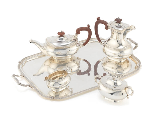 A 20th century silver matched four-piece coffee and tea service together with a tray by Charles S. Green & Co, Birmingham 1970, 1973 and 1978 (5)